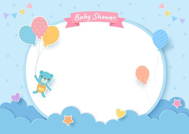 Tarjeta de baby shower con osito de peluche y globos sobre fondo azul.