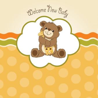 Tarjeta de baby shower con oso de peluche y su juguete