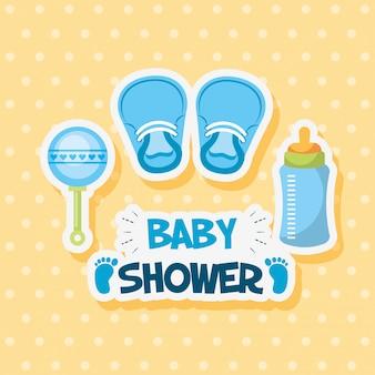 Tarjeta de baby shower con zapatos y accesorios.