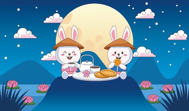 Tarjeta de celebración de mediados de otoño con pareja de conejitos cenando en el lago