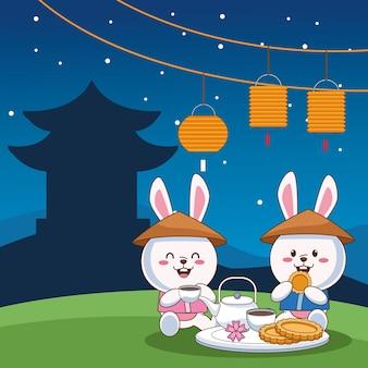 Tarjeta de celebración de mediados de otoño con pareja de conejitos comiendo en el campamento