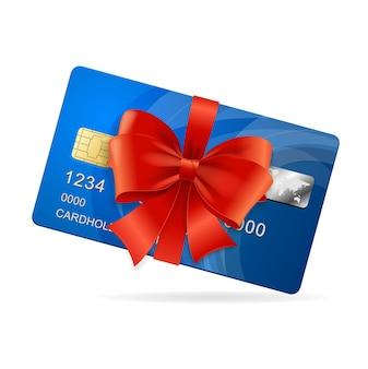 Tarjeta de crédito presente con lazo rojo y lazo.