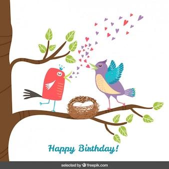 Tarjeta de cumpleaños con pájaros en rama de un árbol