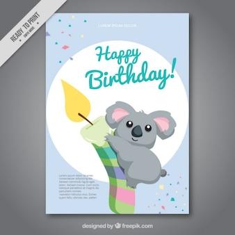 Tarjeta de cumpleaños de simpático koala con una vela