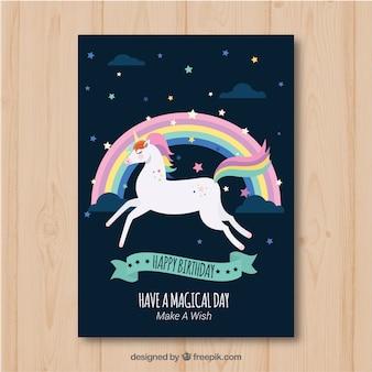 Tarjeta de cumpleaños con un unicornio y un arco iris