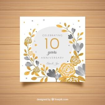 Tarjeta de aniversario de boda con flores doradas
