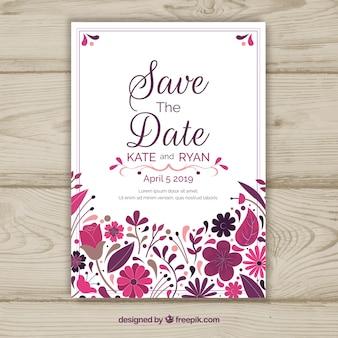 Tarjeta de reserva la fecha con ornamentos florales