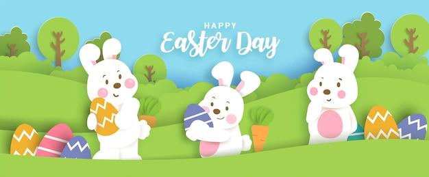 Tarjeta del día de pascua con lindos conejos y huevos de pascua