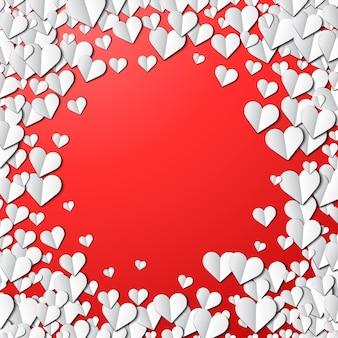 Tarjeta del día de san valentín con corazones de papel cortado dispersos