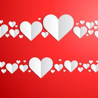 Tarjeta del día de san valentín con líneas de corazones de papel cortado