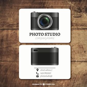 Tarjeta de estudio de foto con una cámara