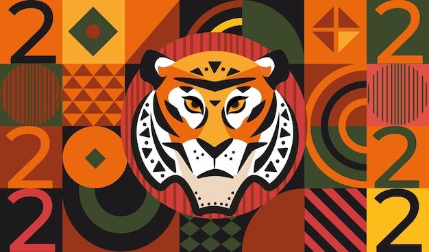 Tarjeta de felicitación de año nuevo 2022 sobre fondo geométrico con formas cuadradas triangulares y redondas y cara de tigre con números. diseño de plantillas para pancartas, folletos, invitaciones, felicitaciones, carteles.