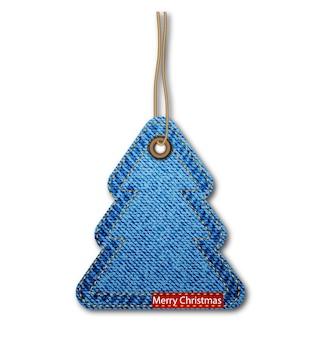 Tarjeta de felicitación con el árbol de navidad en la textura del dril de algodón