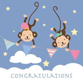 La tarjeta de felicitación en colores pastel rosada azul con el mono sube la bandera