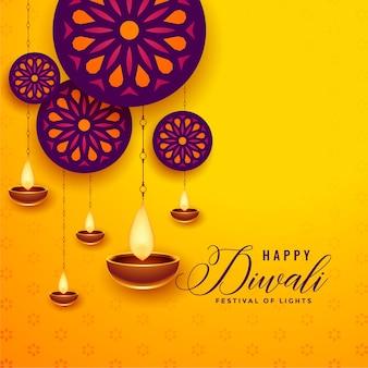 Tarjeta de felicitación decorativa feliz diwali con diya colgante