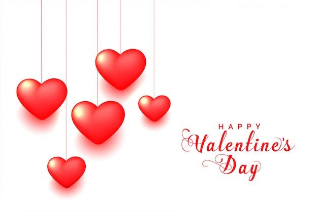 Tarjeta de felicitación del día de san valentín de corazones rojos colgantes 3d