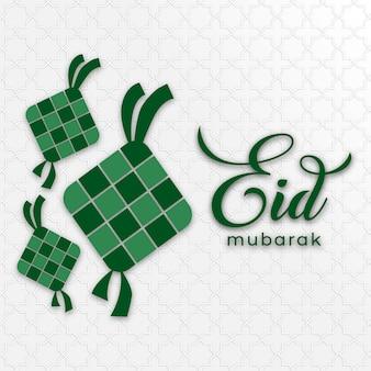 Tarjeta de felicitación de eid mubarak con ilustración de ketupat