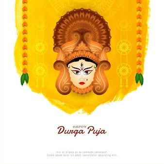 Tarjeta de felicitación étnica del festival de durga puja con cara de diosa