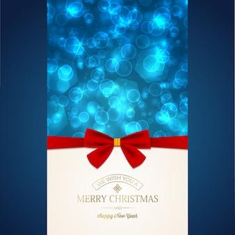 Tarjeta de felicitación de feliz año nuevo con inscripción y lazo de cinta roja en estrellas brillantes