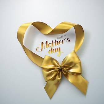 Tarjeta de felicitación feliz del día de las madres con lazo dorado y cinta de corazón