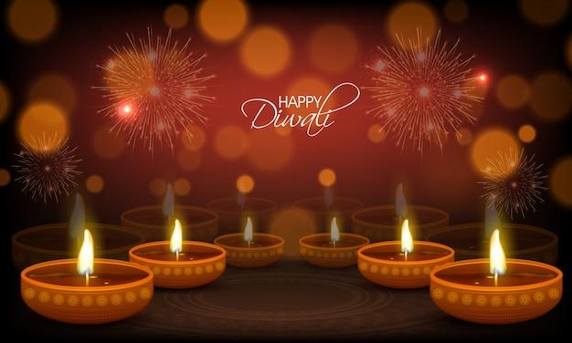 Tarjeta de felicitación feliz de diwali con las lámparas de aceite iluminadas.