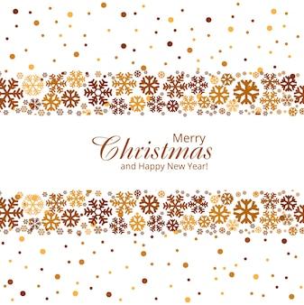 Tarjeta de felicitación de la feliz navidad con el fondo creativo de los copos de nieve