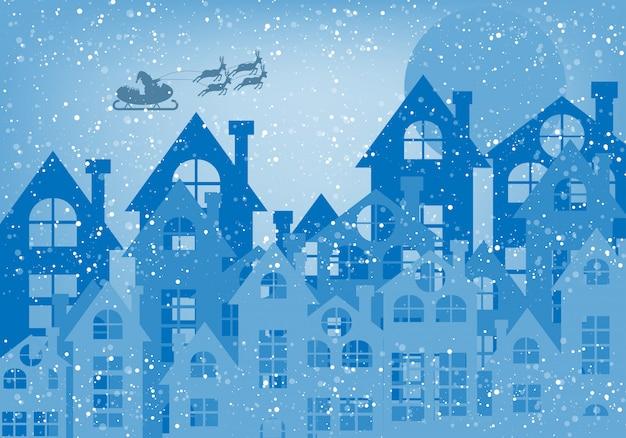 Tarjeta de felicitación de la feliz navidad y papá noel en el cielo con el fondo azul.
