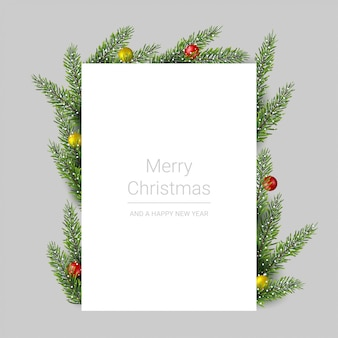 Tarjeta de felicitación de feliz navidad con ramas de pino y bolas de navidad en gris