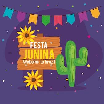 Tarjeta de felicitación de festa junina con cactus e iconos tradicionales