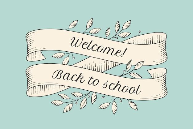 Tarjeta de felicitación con inscripción regreso a la escuela.