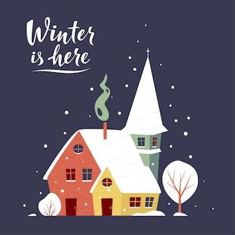 Tarjeta de felicitación de invierno con un pequeño pueblo cubierto de nieve.