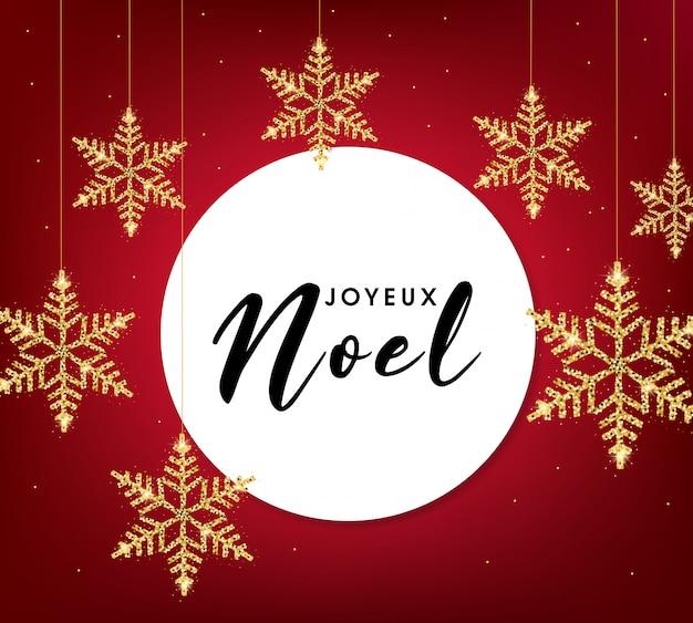 Tarjeta de felicitación de joyeux noel con copos de nieve dorados
