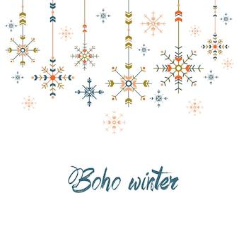 Tarjeta de felicitación de navidad en estilo étnico. copos de nieve geométricos