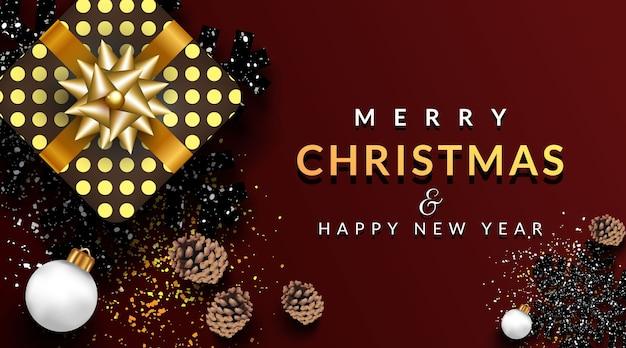 Tarjeta de felicitación de navidad o pancarta con piñas, caja de regalo y hermoso copo de nieve negro