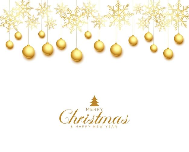 Tarjeta de felicitación navideña con bolas doradas y copos de nieve.
