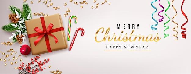 Tarjeta de felicitación navideña con decoraciones realistas.
