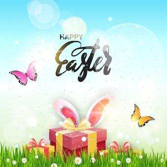 Tarjeta de felicitación de pascua feliz caja de regalo con orejas de conejo en hierba verde