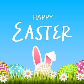 Tarjeta de felicitación de pascua feliz. huevos de pascua y un conejo con pasto.