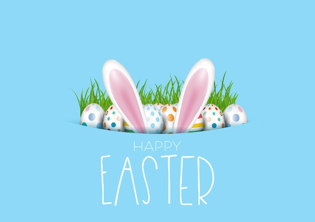 Tarjeta de felicitación de pascua con huevos y orejas de conejo.