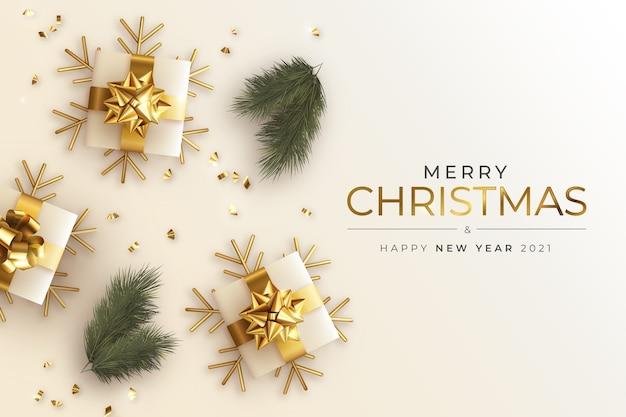 Tarjeta de felicitación realista de navidad y año nuevo con regalos y ramas.