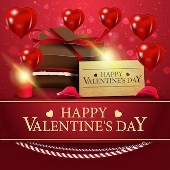 Tarjeta de felicitación roja para el día de san valentín con caramelo de chocolate.