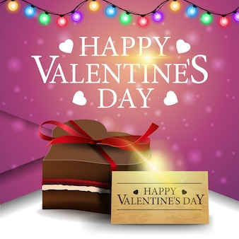 Tarjeta de felicitación rosa para el día de san valentín con caramelo de chocolate.
