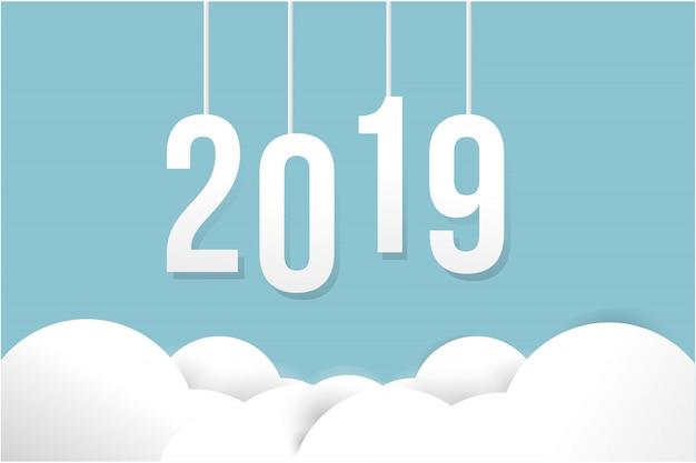 Tarjeta de feliz año nuevo 2019 sobre fondo de color de papel.
