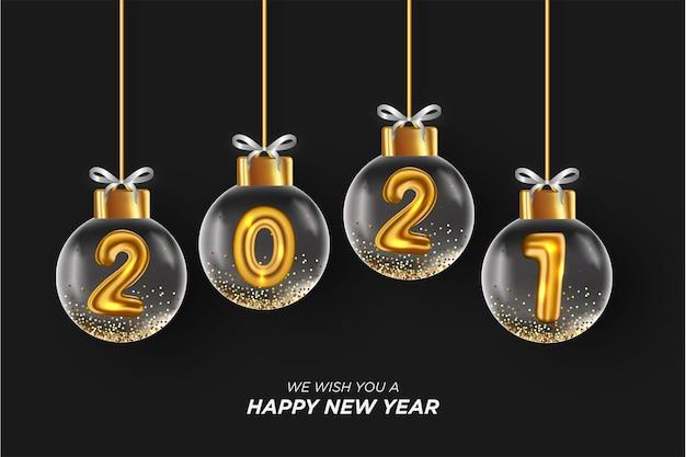 Tarjeta de feliz año nuevo 2021 con bola de navidad realista fondo negro