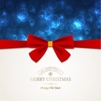 Tarjeta de feliz año nuevo con inscripción de saludo y lazo de cinta roja en estrellas brillantes de luz