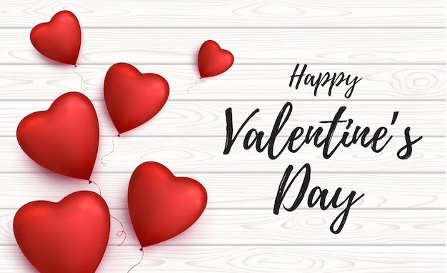 Tarjeta de feliz día de san valentín con globos en forma de corazón.