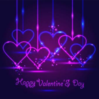 Tarjeta de feliz día de san valentín en neón sobre fondo violeta oscuro.