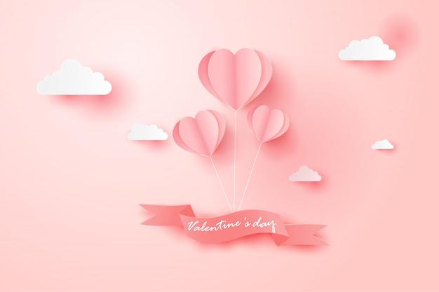 La tarjeta feliz del día de tarjetas del día de san valentín con el globo flota el cielo.