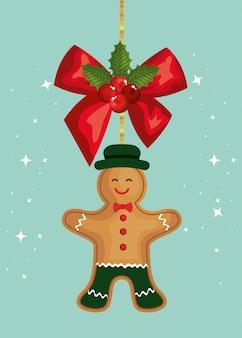 Tarjeta de feliz navidad con arco y galleta de jengibre colgando