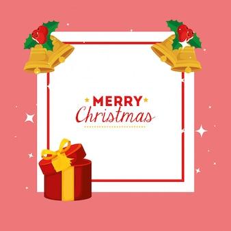 Tarjeta de feliz navidad con caja de regalo y decoración